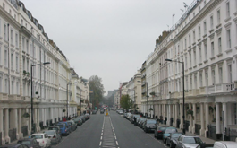 Four men arrested at scene for conspiracy to commit burglary after police halt break-in by using smoke bombs to storm Belgravia mansion